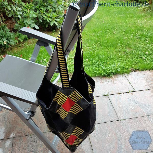 schwarz-gelbe Patchwork-Tasche